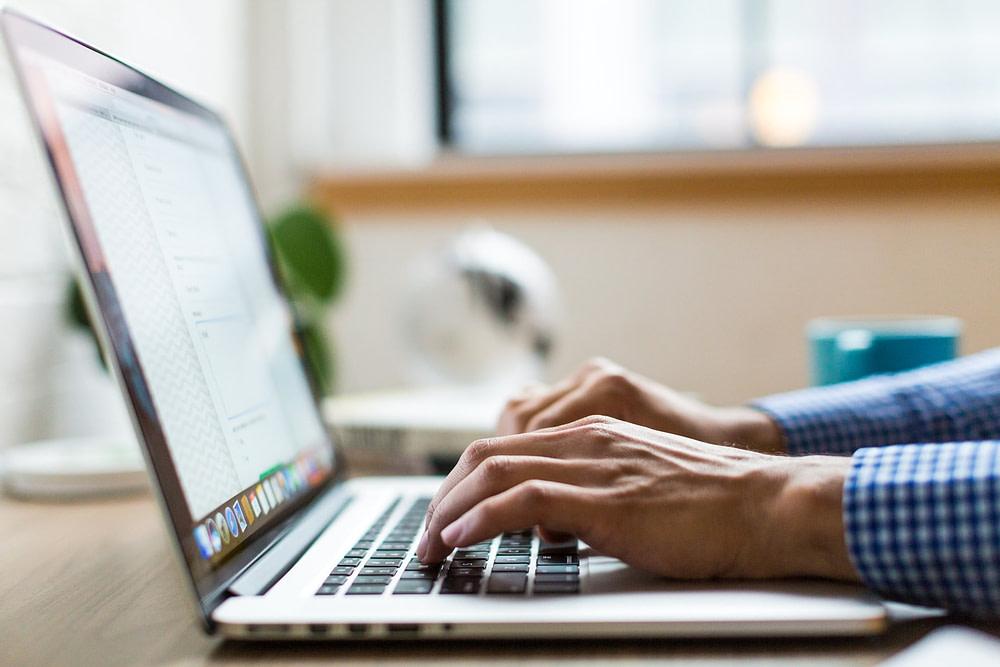 Hands on laptop keypad